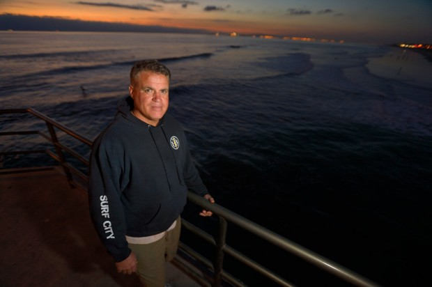 Brian Cizek, manager of the Surf City store on the Huntington Beach Pier on Monday. Cizek helped rescue a jumper from the pier Sunday evening.