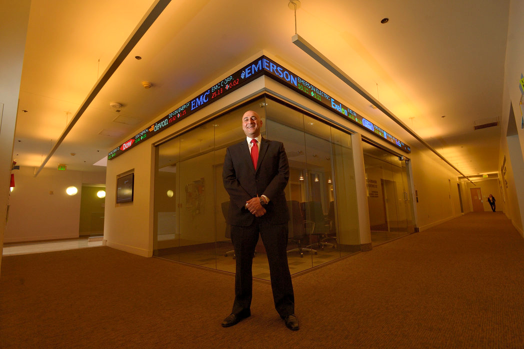Associate professor Fadel Lawandy at the Janes Financial Center at Chapman University in Orange. The business center is part of Chapman University's Argyros School of Business and Economics. Highlights of the center include a live stock ticker and a dozen Bloomberg terminals.
